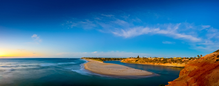 Southport Beach and Onkaparinga river mouth panoramic view at sunset, South Australia Stock Photo
