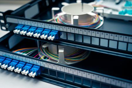 Fibre optic patch distribution panel shelf for enterprise networking Stock Photo