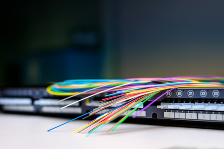 Fibre optic cables on top of patch distribution panel shelf for enterprise networking Stockfoto