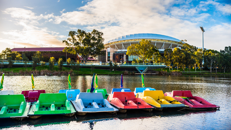 Adelaide, Australia - August 27, 2017: Adelaide Oval viewed across Torrens river in Elder Park at sunset