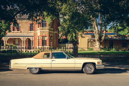Adelaide, Australia - January 18, 2015: Legendary American Cadillac de Ville car parked in Adelaide city centre on the street on a bright day