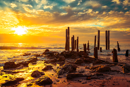 Port Willunga jetty pylons in the water at sunset,  South Australia Stock Photo