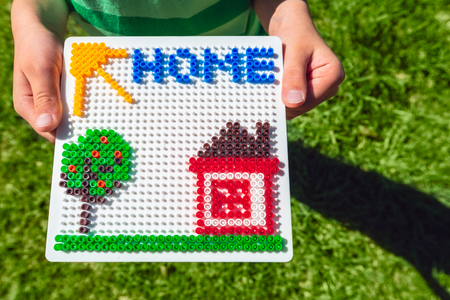 Home concept made from colorful plastic beads Stock Photo
