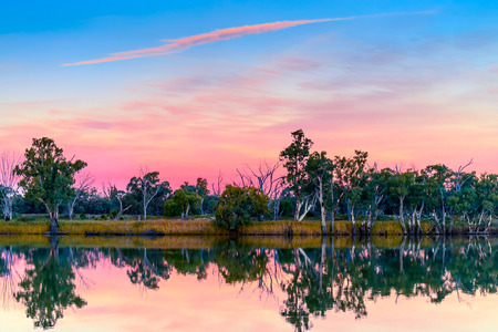 Murray river shores reflected in water at sunset, Riverland, rural South Australia