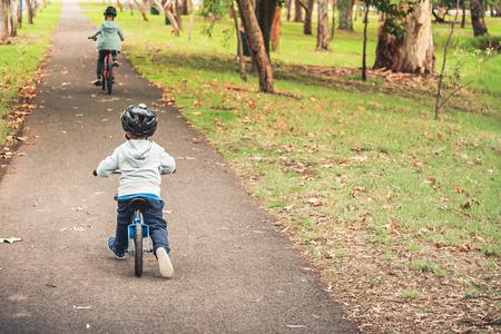 Two australian kids riding their bicycles in Adelaide, South Australia