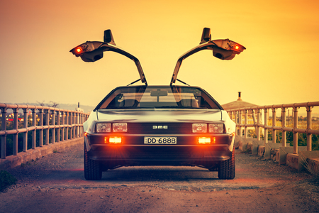 Adelaide, Australia - September 7, 2013: DeLorean DMC-12 car with opened gullwing doors parked on the bridge at dusk