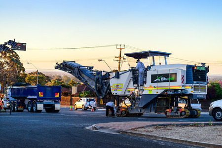 Adelaide, South Australia - November 27, 2017: Night works preparation for new road profiling and asphalt lay with use of modern cold milling machine on Springbank Road Éditoriale