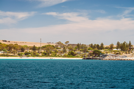 Penneshaw, South Australia - January 14, 2019: SeaLink Ferry Terminal with pier viewed from ferry arriving at Kangaroo Island on a summer day