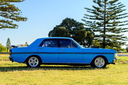 Port Adelaide, South Australia - October 14, 2017: Side view of iconic Australian made Ford Falcon 351-GT parked on the grass on a day