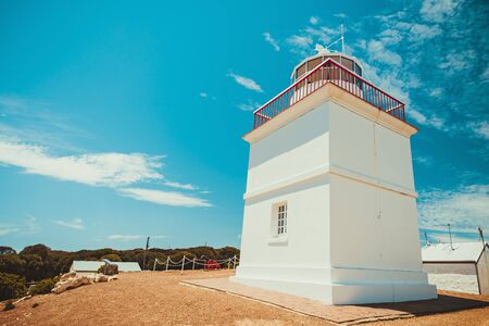 Iconic Cape Borda Lighthouse with cannon on a bright summer day, Kangaroo Island, South Australia
