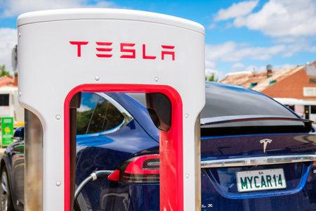 Adelaide CBD, Australia - November 18, 2017: Tesla Supercharger EV charging station with Tesla Model X car in city centre on Franklin Street on a day