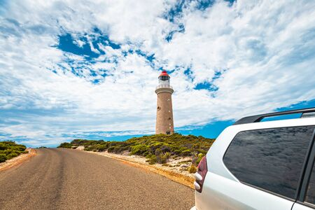 Cape Du Couedic lighthouse under beautiful sky by the road