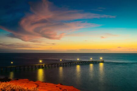 Port Noarlunga pier with light on after sunset, South Australia. Long exposure camera settings Stock Photo