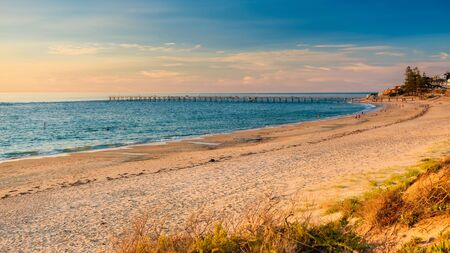 Port Noarlunga south beach coastline with people at sunset