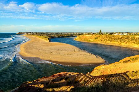 Onkaparinga River Mouth Viewpoint and Port Noarlunga South at sunset Stock Photo