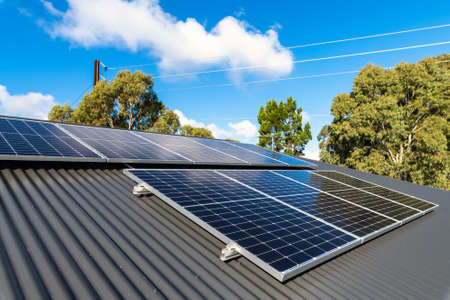 New solar panels installed on metal sheet roof of the house in South Australia