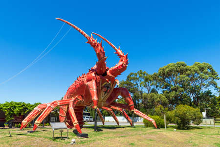 Kingston SE, South Australia - February 14, 2021: The Big Lobster is a tourist attraction on the way to Mount Gambier known locally as Larry the Lobster. The sculpture is made of steel and fibreglass and was intended to attract attention to the local rest