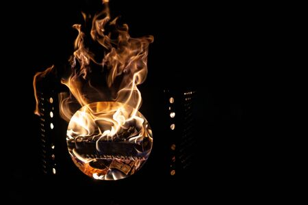 Bon fire in a barrel. Flames sticking out, burning wood Archivio Fotografico - 138046915