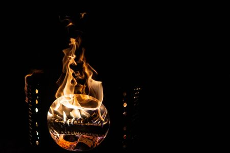 Bon fire in a barrel. Flames sticking out, burning wood Archivio Fotografico - 138046700