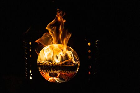 Bon fire in a barrel. Flames sticking out, burning wood Archivio Fotografico - 138047211