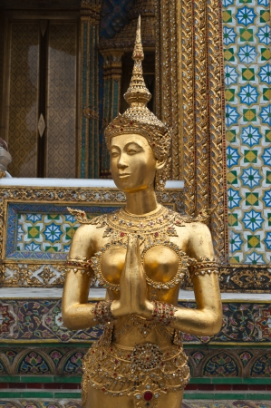 Golden Angel in Phra Kaew Temple, Bangkok Thailand, Public art  photo