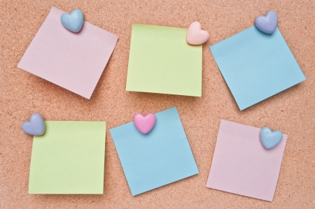 Paper color blank notes on cork board texture and  lovely Heart-shaped pins