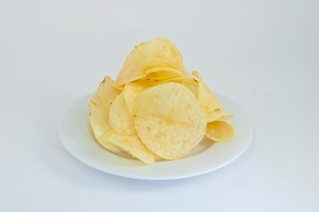Potato chips, clipping path included on the white plate photo