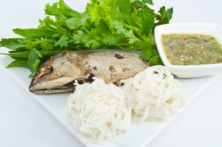 Thai Mackerel with vegetables and spicy sauce with flour length  photo