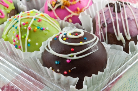 Sweet chocolate ball many color in the white cup paper  photo