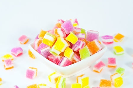 A pile of candies on a white background. Close-up of colorful candy . photo