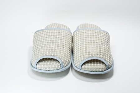 Pair of house slippers with reflection on white background photo