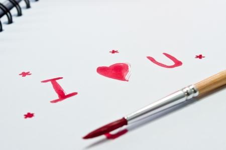 i love u: J'aime u �crire un livre avec aquarelle sur white.With une piscine. Banque d'images