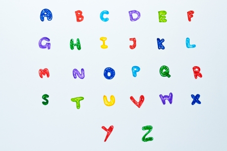 Colorful alphabet hand writing on white background. photo
