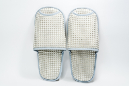 Pair of house slippers with reflection on white background Stock Photo - 14811094