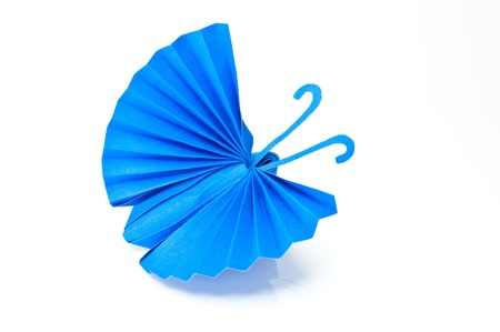 Origami Japanese blue paper butterflies on white background.