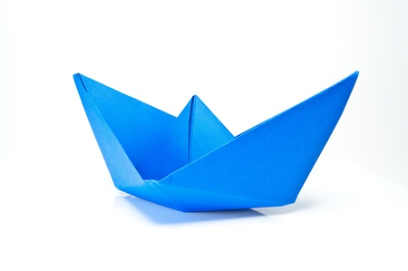 Origami blue paper ship on white background.