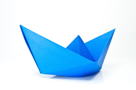 paper fold: Origami blue paper ship on white background.
