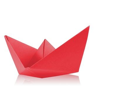 Close up origami paper ship on white background