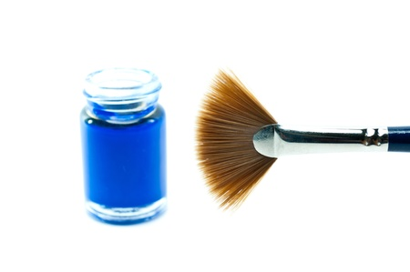Blue bottle with a paintbrush on a white background