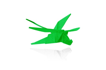 Paper dragonfly in flight isolated on a white background, Origami. Stock Photo