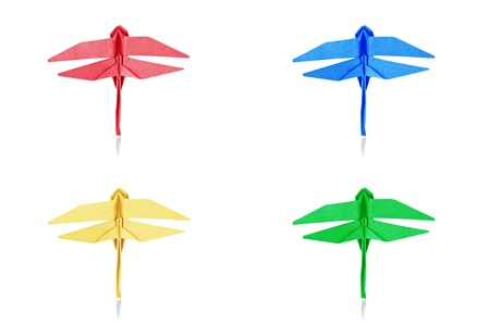 Origami blue paper dragonfly on white background