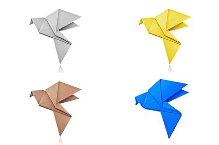 Origami Gray paper bird on white background. photo