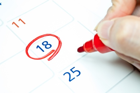 Red color  Mark on the calendar at 18  Stock Photo