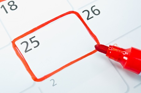 Red color writing on the calendar at 25