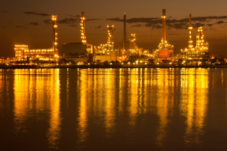 Oil refinery at night,Chao Phraya river, Bangkok Thailand photo