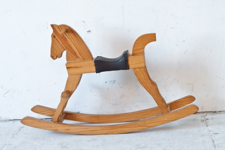 Small Antique brown wooden rocking horse toy. photo