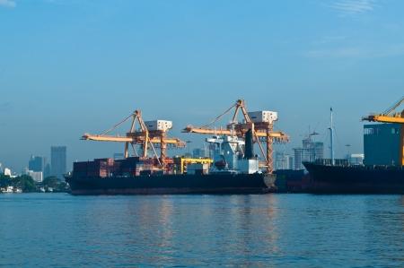Shipping port at Chao Phraya river, Bangkok Thailand photo
