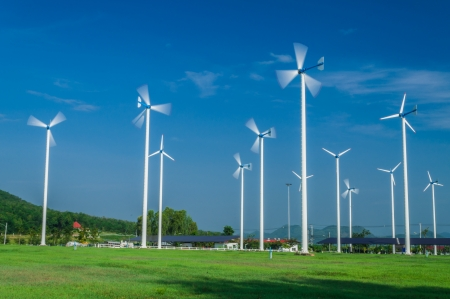 White wind turbine. Subaltern's mountains and sky in the background. Stock Photo - 16962551