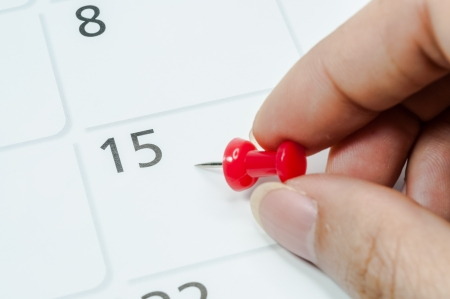 Red pins mark the 15th on your calendar. Stock Photo