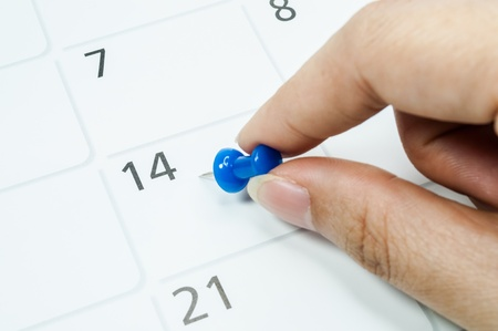 Blue pins mark the 14th on your calendar.